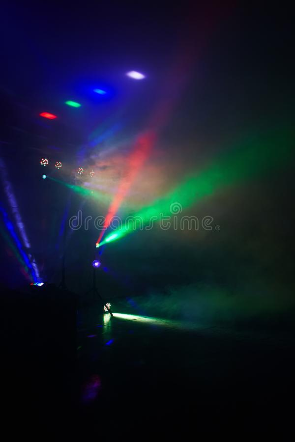 Stage lights in action at the concert. Lights show. Lazer show. Night club dj party people enjoy of music dancing sound with colorful light. club night light stock photo