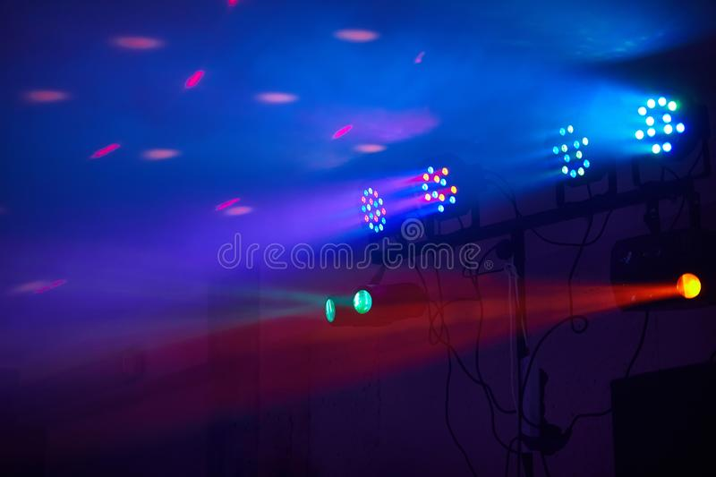 Stage lights in action at the concert. Lights show. Lazer show. Night club dj party people enjoy of music dancing sound with colorful light. club night light royalty free stock images