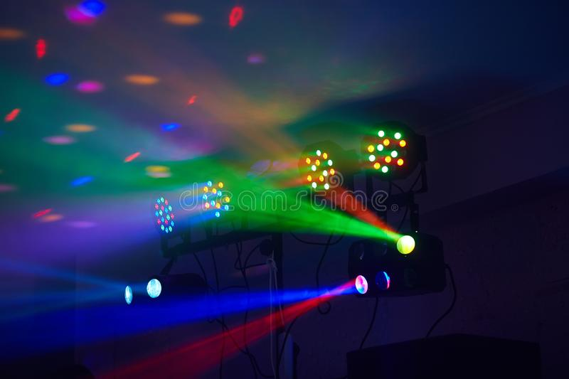 Stage lights in action at the concert. Lights show. Lazer show. Night club dj party people enjoy of music dancing sound with colorful light. club night light stock photography