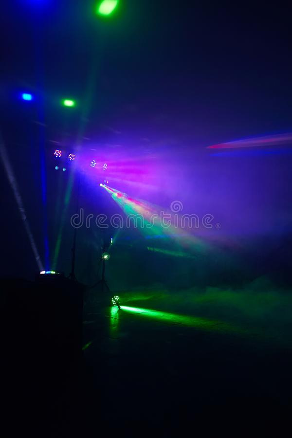 Stage lights in action at the concert. Lights show. Lazer show. Night club dj party people enjoy of music dancing sound with colorful light. club night light royalty free stock photos