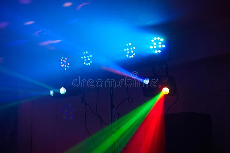 Stage lights in action at the concert. Lights show. Lazer show. Night club dj party people enjoy of music dancing sound with colorful light. club night light stock image