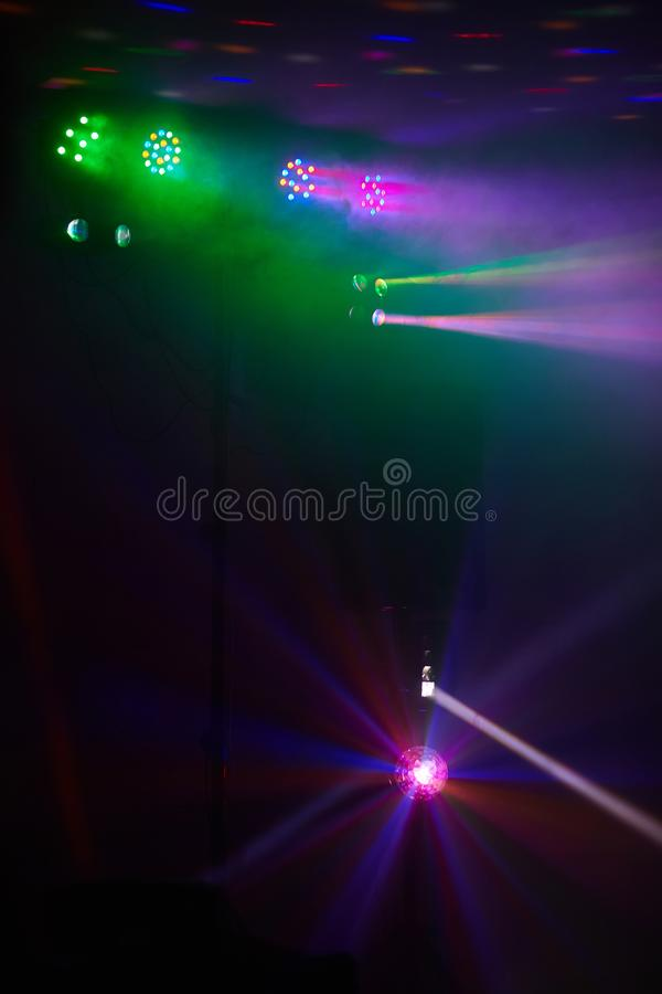 Stage lights in action at the concert. Lights show. Lazer show. Night club dj party people enjoy of music dancing sound with colorful light. club night light stock images
