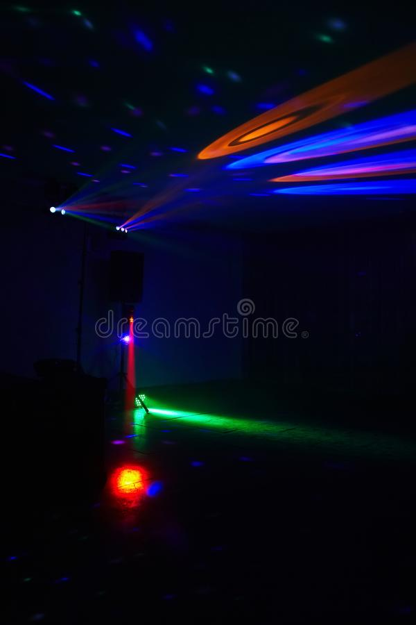 Stage lights in action at the concert. Lights show. Lazer show. Night club dj party people enjoy of music dancing sound with colorful light. club night light royalty free stock photography