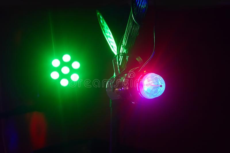 Stage lights in action at the concert. Lights show. Lazer show. Night club dj party people enjoy of music dancing sound with colorful light. club night light stock photos