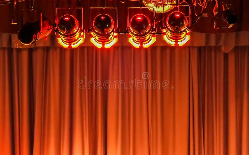 Stage lights and curtain. Stage lights in red and curtain stock photo