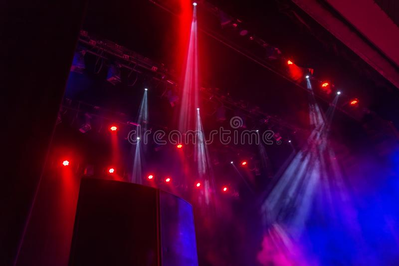 Stage lights. Several projectors in the dark. Multi-colored light beams from the stage spotlights on the stage in the smoke at th royalty free stock photo