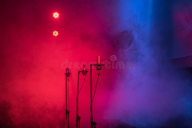 Stage lights. With smoke and microphones stock image