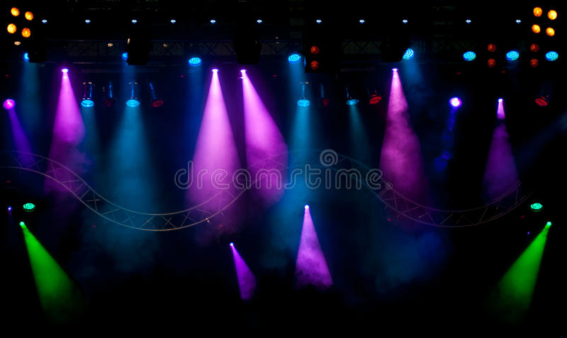 Stage lights with smoky effect background stock image
