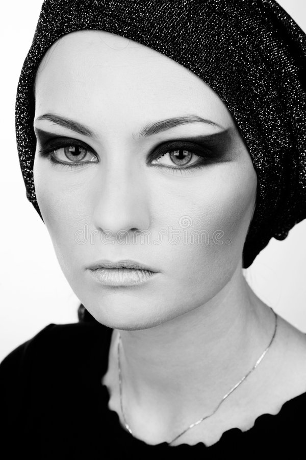 Stage makeup. Black and white portrait of beautiful young woman with stage makeup royalty free stock image