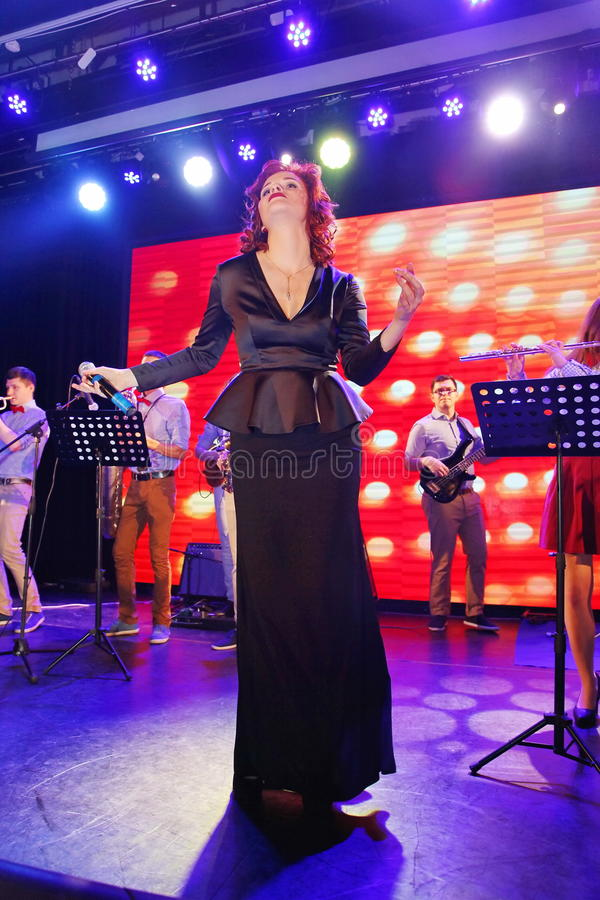 On stage, the musicians pop-rock group Spearmint and singer Anna Malysheva. Red headed Jazz Rock Girl singing. On the stage of a nightclub Olympia, Saint stock photos