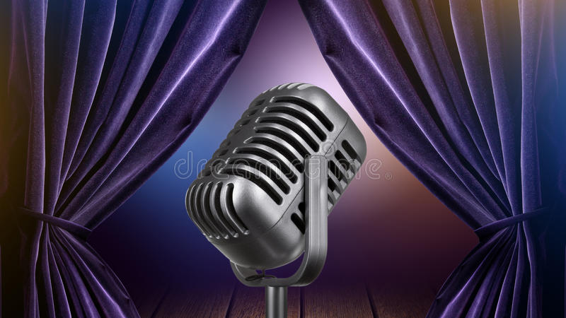 Stage with open curtains and microphone stock image