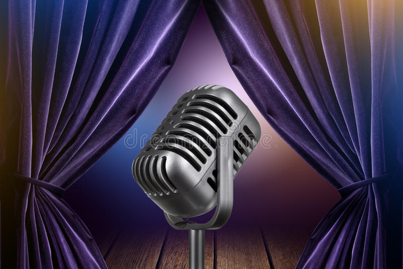 Stage with open curtains and microphone royalty free stock images