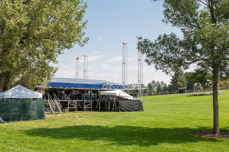 Stage at Outdoor Concert Venue. On green hill stock photography