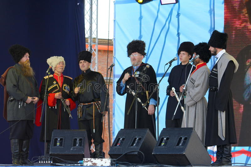 On stage are singers, actors, chorus members, of the corps de chorus and soloists of the Cossack ensemble royalty free stock photo