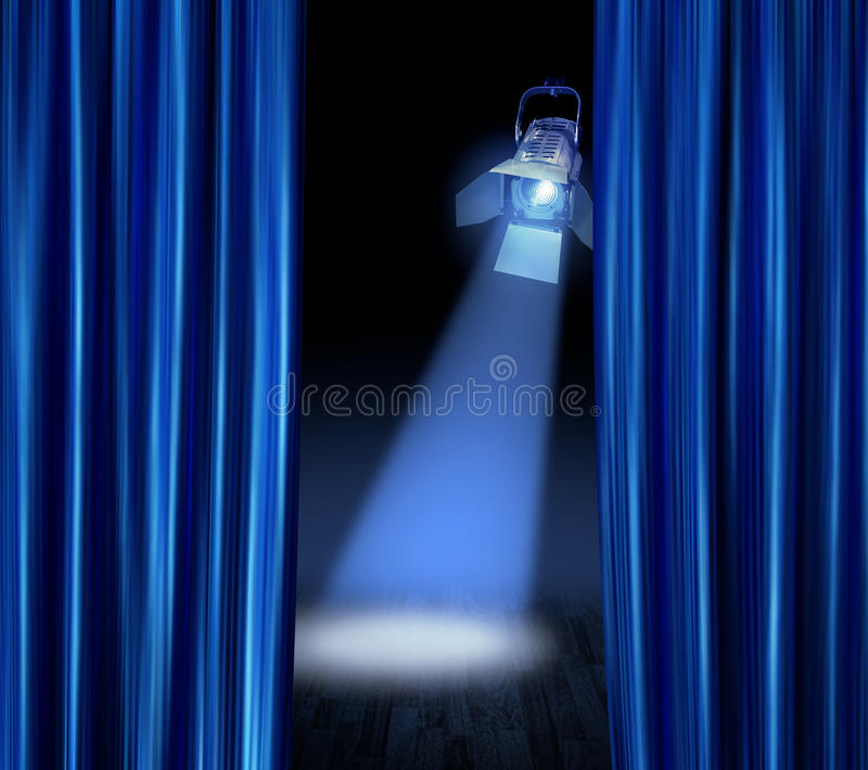 Stage spotlight blue curtains stock photography