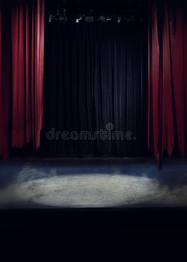 A stage with torn drapes stock photos