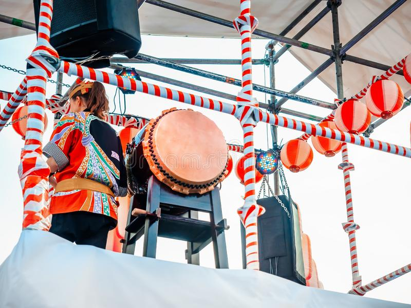 The stage of the Yagura with a drummer girl big japanese taiko drum Wadaiko. Paper red-white lanterns Chochin Scenery royalty free stock images