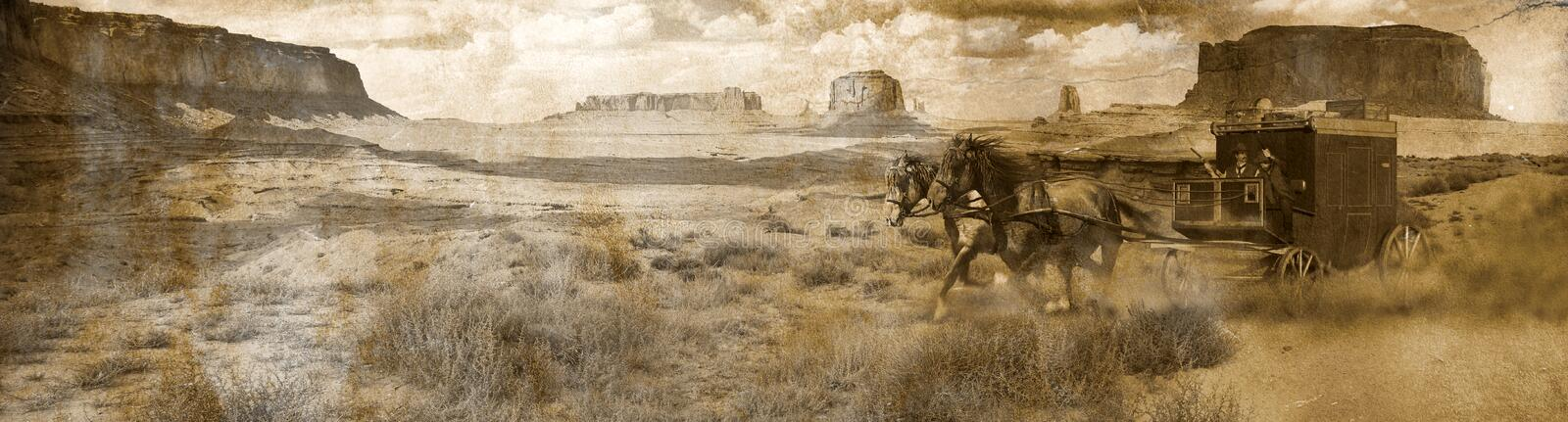 Stagecoach Panoramic. A fast stagecoach pulled by two horses, crosses the desert of Monument Valley raising a cloud of dust. We can see two men on the stagecoach