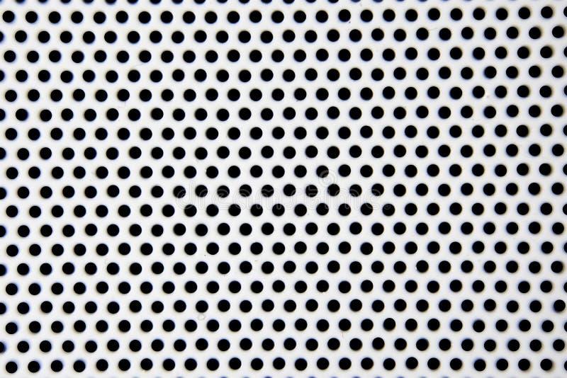 Stahlmusterhintergrund des weißen Lochs stockbild