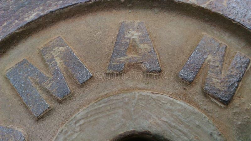 Stahlplatte das Wort, das Mann hat stockfotos