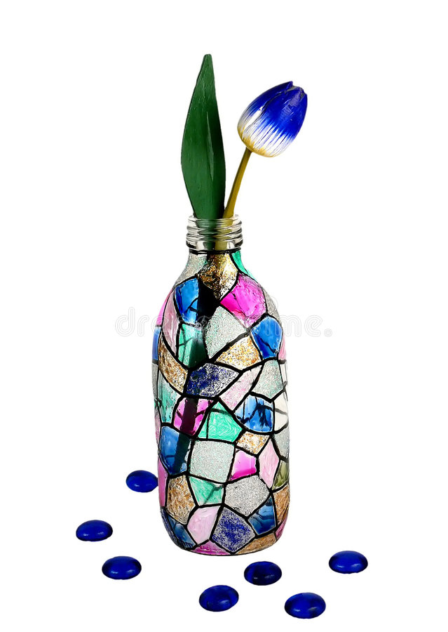 Stain glass bottle. With tulip isolated on white background royalty free stock images