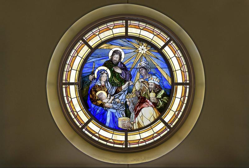 Stain glass of Nativity Epiphany Adoration of the Magi. Tiffany stain glass image with Holy Family Blessed Virgin May Saint Joseph Christ Child Jesus Three Kings stock image