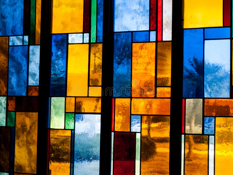 Stain Glass. A very large stain glass window in a local church royalty free stock image