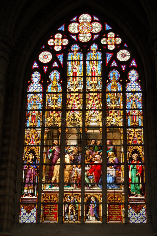 Stain glass window. In big church stock photography