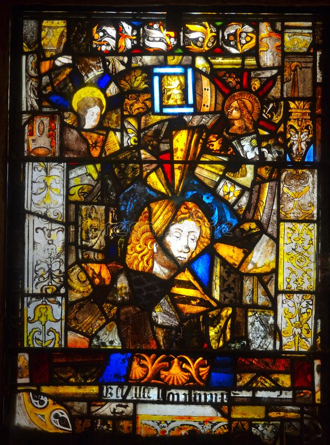 Stain Glass Window made of pieces of ancient broken glass, stock photo
