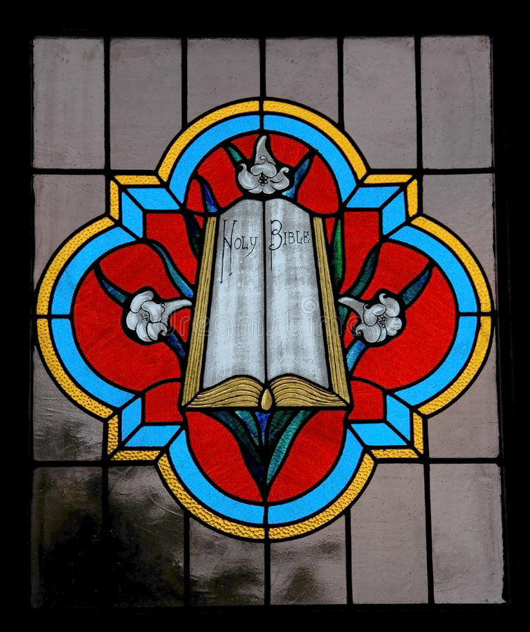 Stained Glass. Holy Bible in Stained Glass stock photography