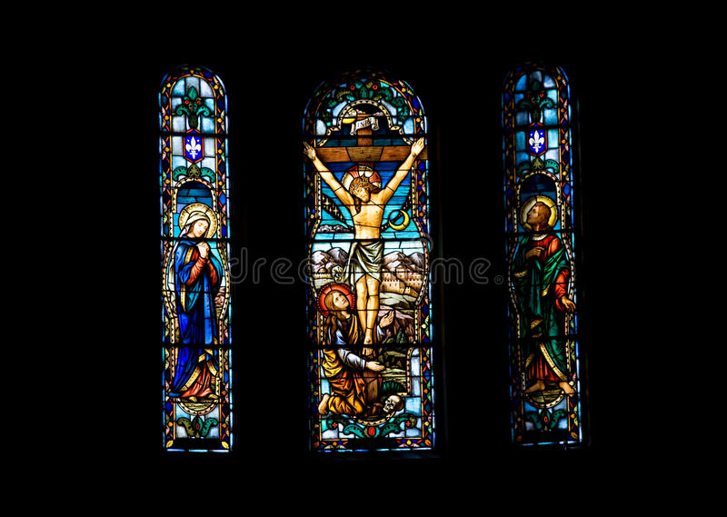 Stained glass. Church window depicting Jesus on the cross royalty free stock photos