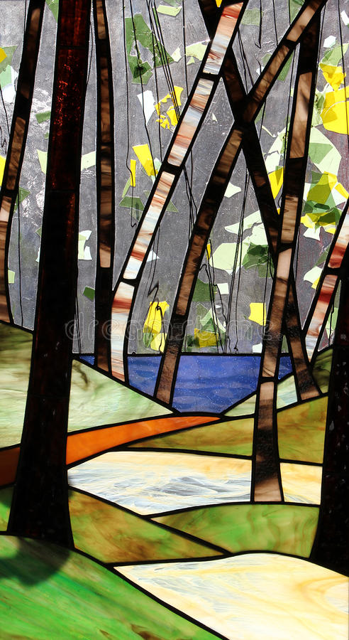 Stained Glass. Forest in stained glass window stock photography