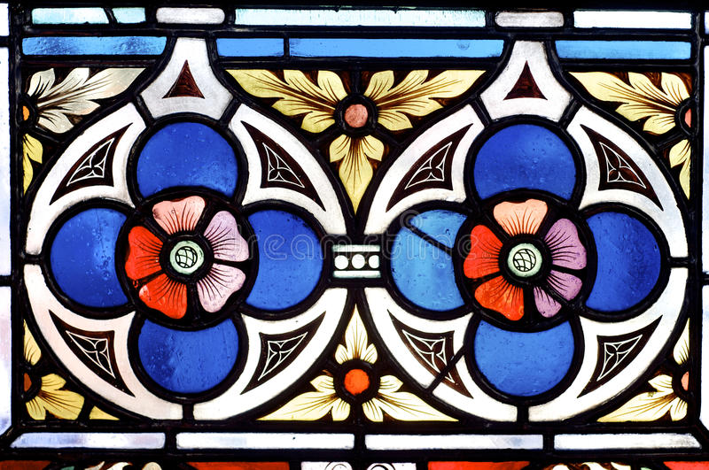 Stained glass. With two red flowers in Prague stock photography
