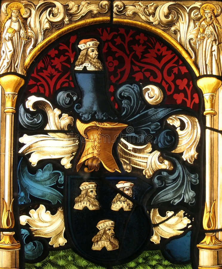 Stained Glass. Found in the castle of Gruyeres. It represents an emblem with the king's head royalty free stock photography