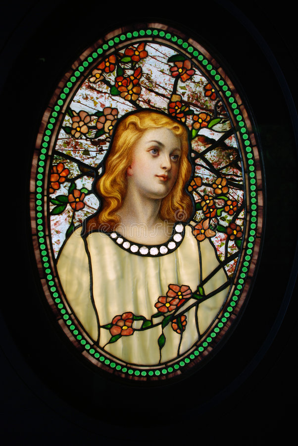 Stained glass. Window.Portrait of young Female.Located at Chicago's Navy Pier stock photo
