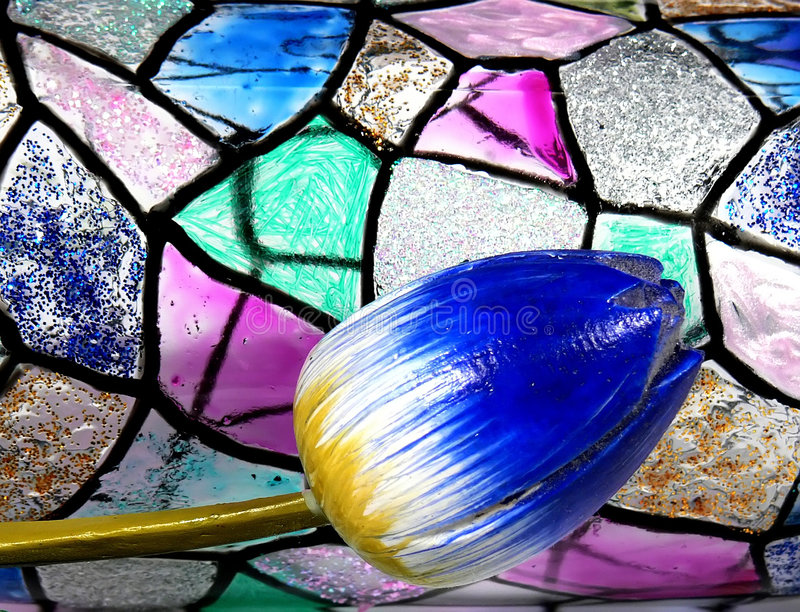 Stained glass. Vitrage with tulip royalty free stock image