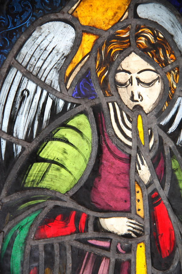 Stained glass angel. Colorful stained glass angel church window stock images