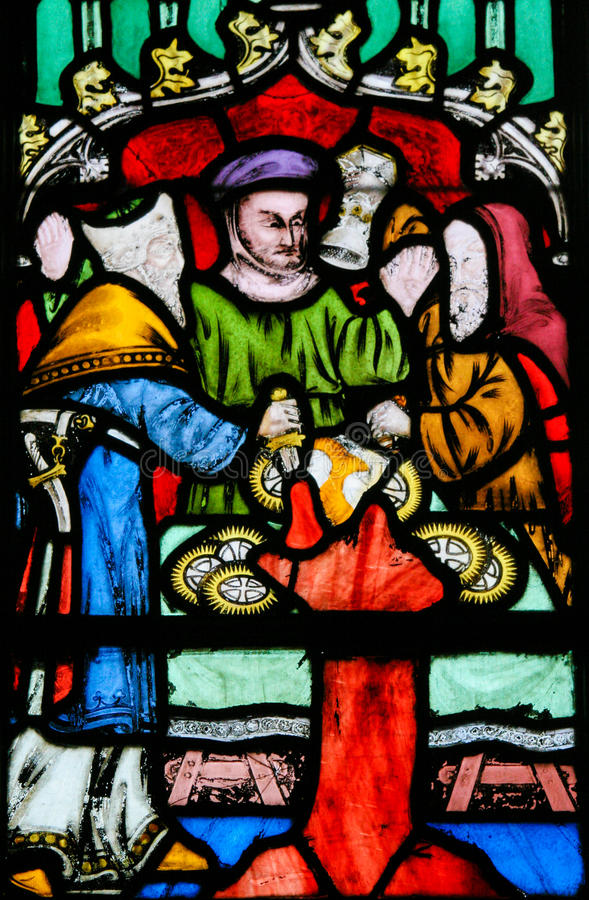 Stained Glass - Antisemitic legend of Jews stealing sacramental. Stained Glass window in the Church of Braine-le-Chateau, Wallonia, Belgium, depicting the stock photography