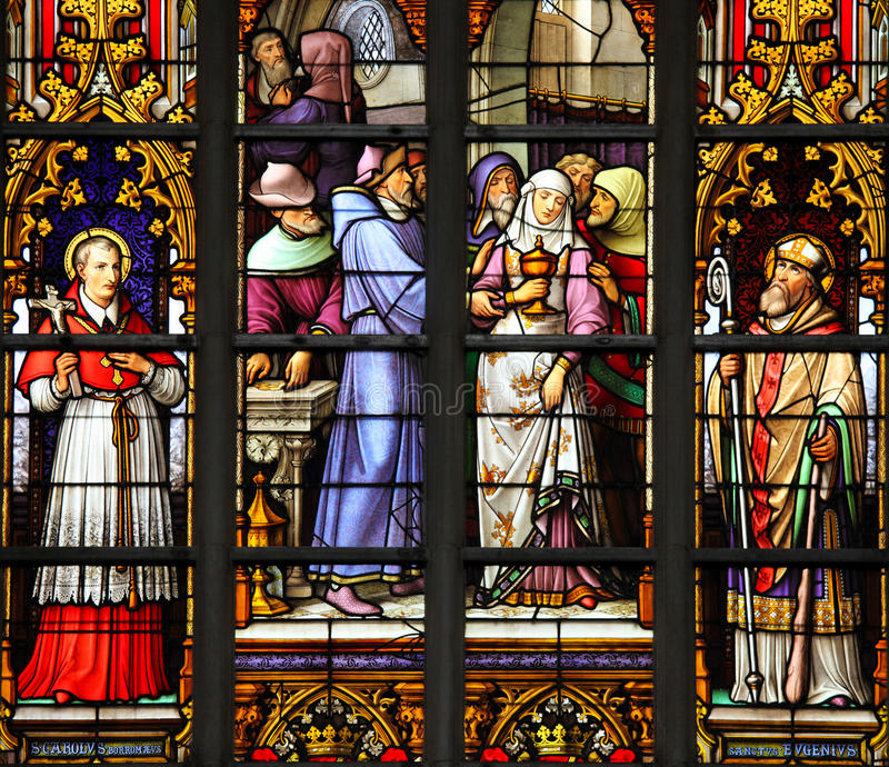 Stained Glass - Antisemitic stained glass in Brussels Cathedral. Stained Glass depicting the antisemitic legend of desecrated sacramental bread, whereby a female royalty free stock photos