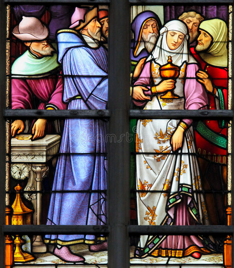 Stained Glass - Antisemitic stained glass in Brussels Cathedral. Stained Glass depicting the antisemitic legend of desecrated sacramental bread, whereby a female stock image