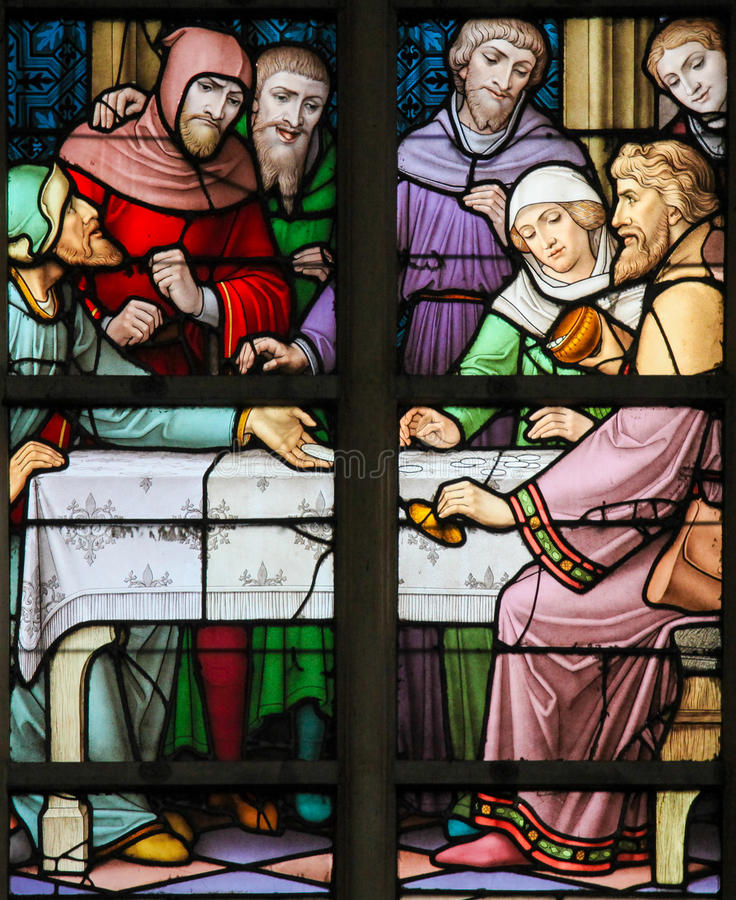 Stained Glass - Antisemitic stained glass in Brussels Cathedral. Stained Glass depicting the legend of Jews stealing sacramental bread, in the Cathedral of royalty free stock photography