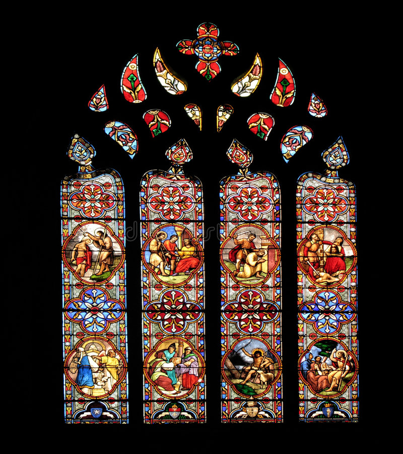 Stained glass arch. Ed window in a cathedral royalty free stock image