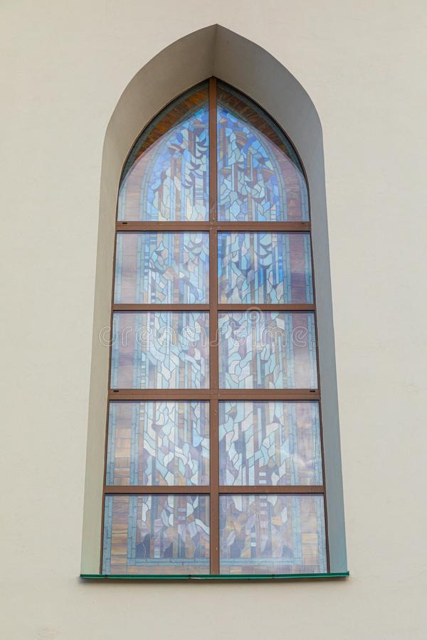 Stained glass arched window of church. Stained-glass arched window of cathedral in Minsk, Belarus stock photo