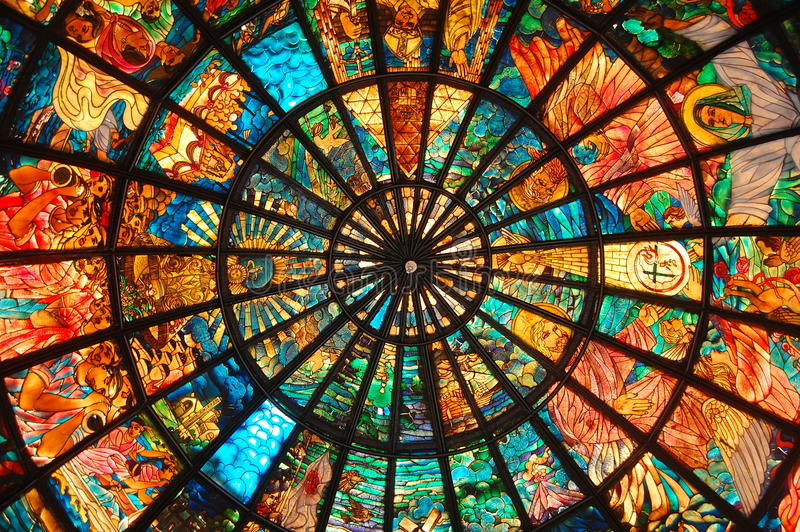 Stained Glass Art. Stained glass adorning the dome of a small structure in front of a cathedral in Camarines Sur, Bicol, Philippines royalty free stock photo