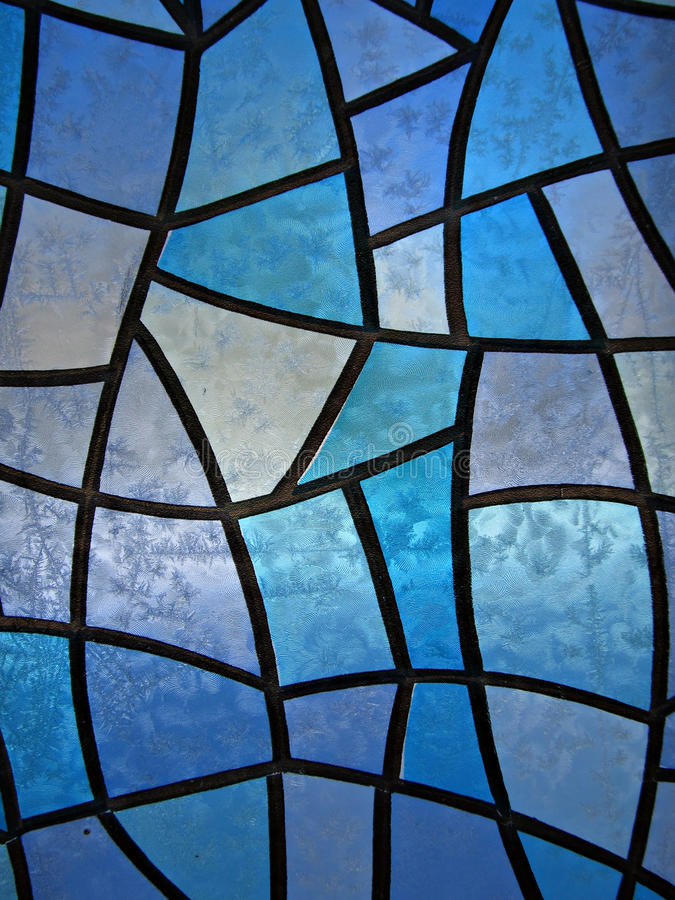 Stained glass background with ice flowers. Seasonal Background with stained glass and frozen ice flowers. Distant shot stock photography