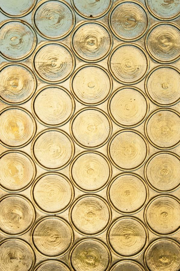 A stained glass background, old church window with stained glass, opaque yellow circles royalty free stock image