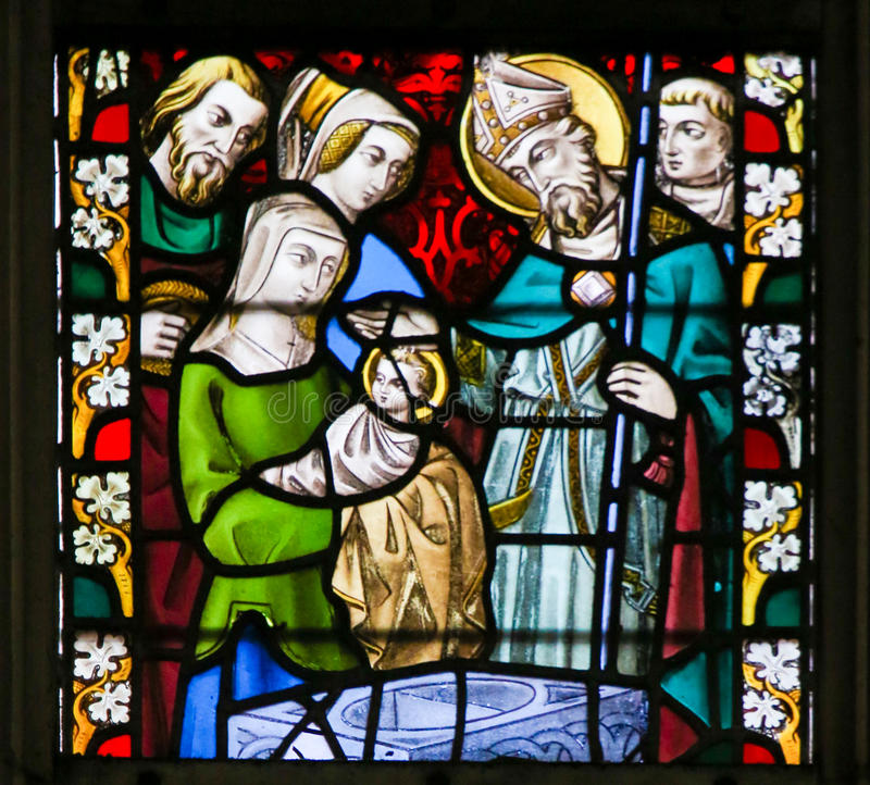 Stained Glass - Baptism. Stained Glass window depicting a Baptism in the Cathedral of Saint Bavo in Ghent, Flanders, Belgium stock images