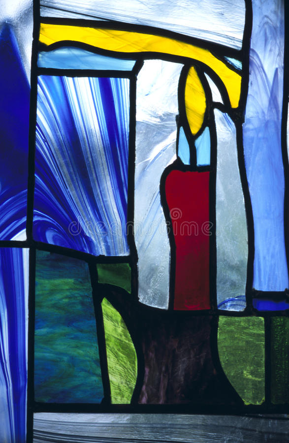 Stained Glass Candle In Chapel Royalty Free Stock Images