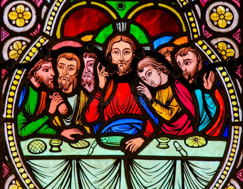 Jesus and the Apostles at the Last Supper on Maundy Thursday. Stained Glass in the Cathedral of Monaco, depicting Jesus and the Apostles at the Last Supper on stock photo