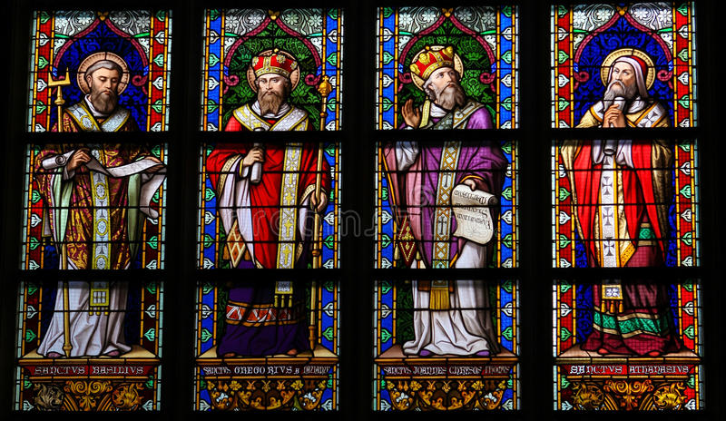 Stained Glass of Catholic Saints in Den Bosch Cathedral. Stained Glass Window depicting Saint Basil of Caesarea, Gregory of Nazianzus, John Chrysostom and stock images